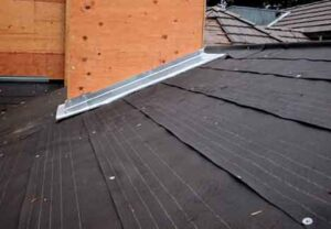 Beneath tile roofing, 30-pound roofing felt on a plywood deck sheds the water.