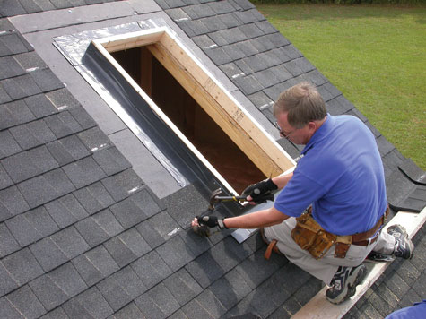 Before adding the skylight, this contractor is building a curb and weaving the curb's flashing into the shingles.