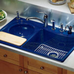 Laminate countertop provides simple backdrop for dramatic kitchen sink.