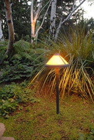 Outdoor lighting invites guests to a home.