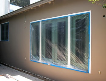 how to paint stucco siding hometips. Black Bedroom Furniture Sets. Home Design Ideas