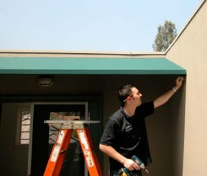 Installing an awning is a inexpensive way to reduce solar heat gain. Photo: © HomeTips