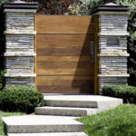 wooden gate stone pillars
