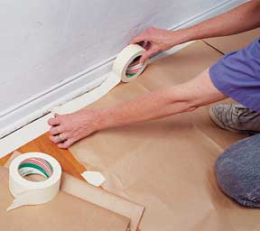 Tape protective drop cloths to the floor, and then the walls.