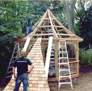 Kit gazebo's roof panel is lifted into place. Photo: Summerwood Outdoors Inc.