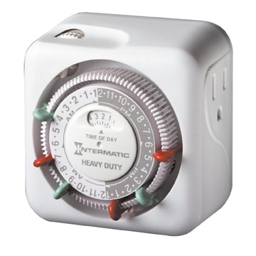 Inexpensive mechanical timer plugs into a receptacle and controls one light. Photo: Intermatic