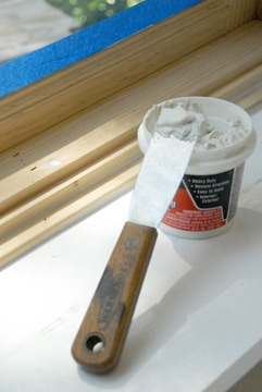 Use vinyl spackling compound to fill any holes and run a bead of caulking compound along seams between moldings before painting.