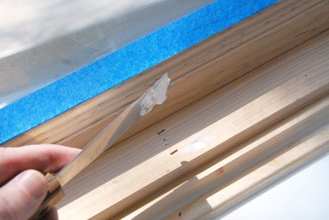 Fill holes in woodwork with spackling compound and sand smooth before painting.