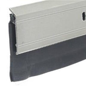 Door sweep seals out the weather beneath an exterior door. Photo: Thermwell Products
