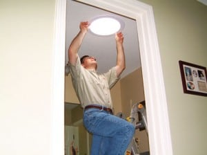 The final step of installing a tubular skylight is mounting its trim on the ceiling.