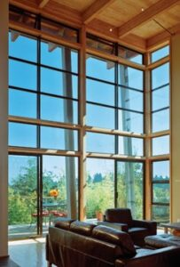 A combination of fixed and operable windows fills this spacious home with light and views. Photo: Milgard
