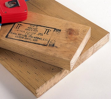 Wood Preservers stamp shows grade of pressure treatment.