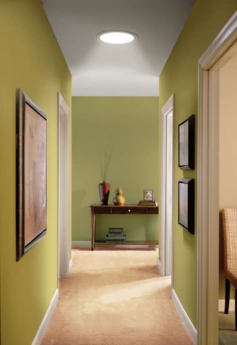A new tubular skylight transforms an otherwise dark hallway with natural light.