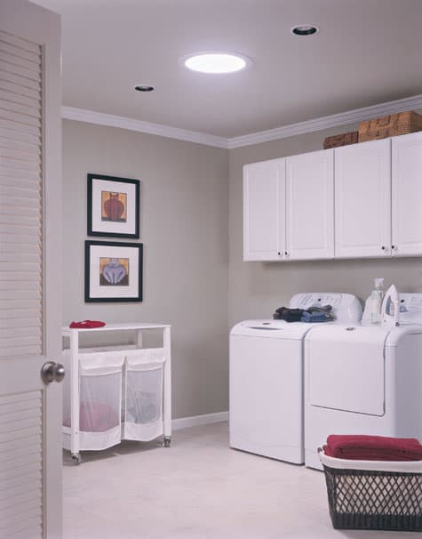 Tubular skylight brightens a windowless laundry room, minimizing the need for electrical lighting.
