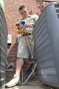 HVAC professional checks the refrigerant levels in an air conditioning system.