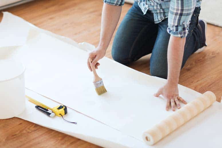 Apply paste to the back of the wallpaper strip.
