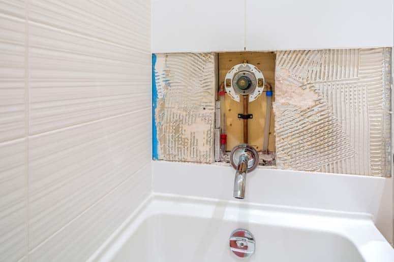 The diverter valve in a bathtub switches the flow of water from the spout to the shower head.