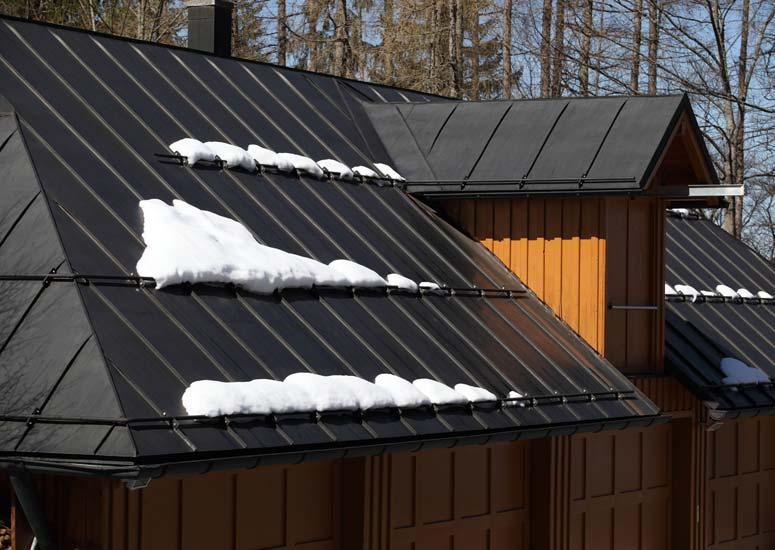 Metal roofing is great in snow country because it is fire resistant, lightweight, and excellent at shedding snow.