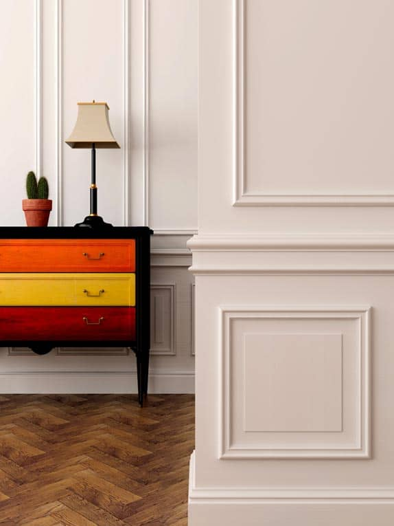 Wainscoting and decorative moldings add traditional style and elegance to these walls.