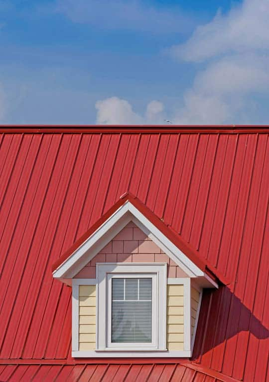 Brightly colored standing-seam metal roof does a great job of shedding water and snow with very little maintenance required.