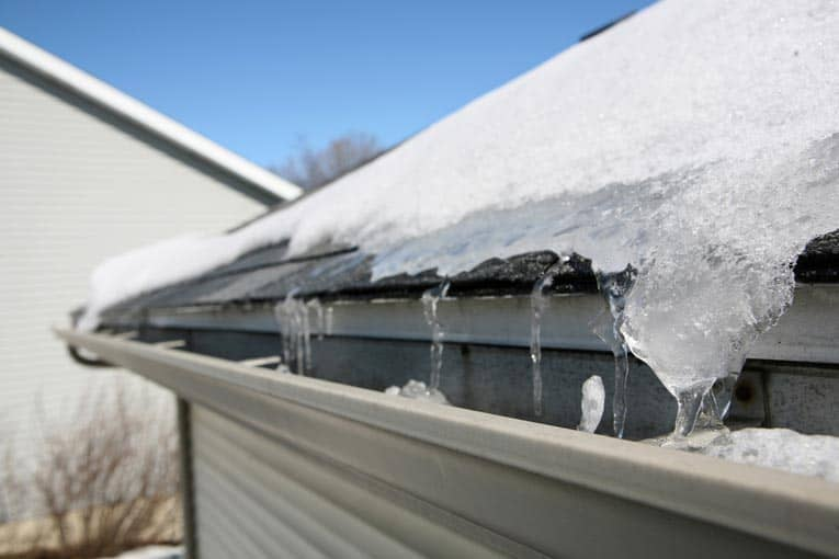 Ice dams cause water to back up the roof and leak underneath the shingles.