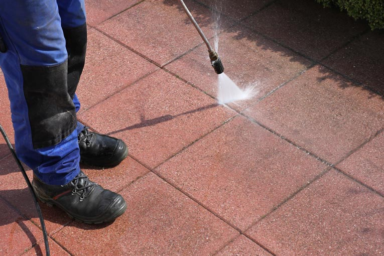 Power washing is an effective way to clean grit from driveways, patios, and walkways.