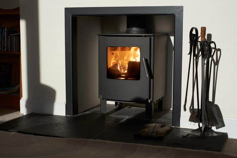 Wood-burning fireplace insert makes a conventional fireplace far more efficient.