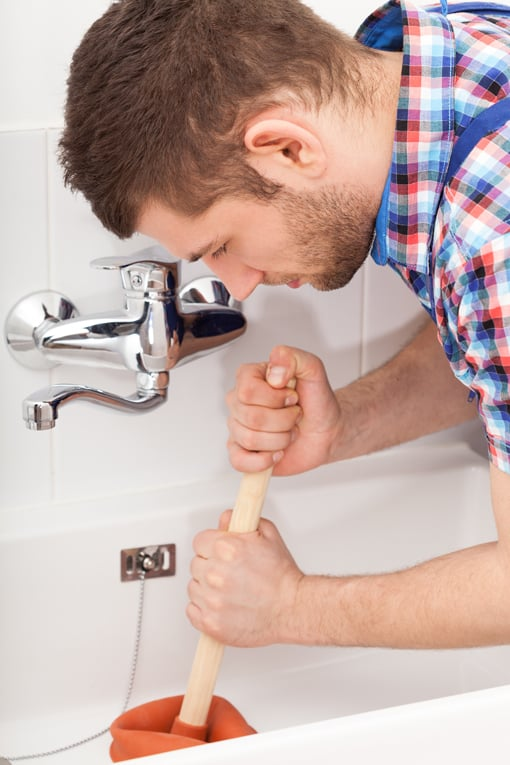 Use quick, stabbing motions with a flat drain plunger to clear a drain blockage.
