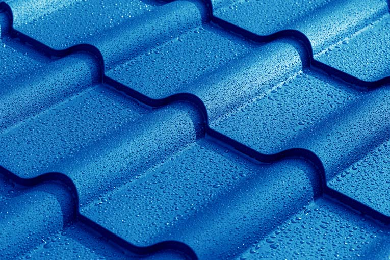Blue steel roofing in a tile pattern, is sold in linear panels. Baked-on finishes carry long-term warranties.