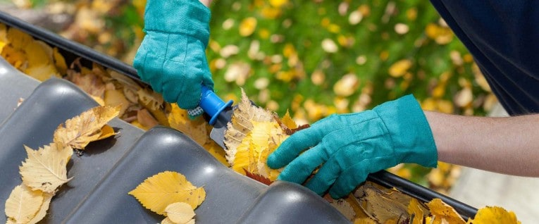 A small garden trowel makes scooping debris out of gutters an easier job. Wear gloves to protect your hands from muck, sharp metal, and sheet metal screws.