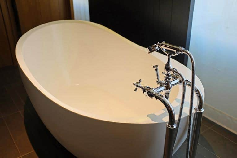 Freestanding bathtub is a sculptural centerpiece in this contemporary bathroom.