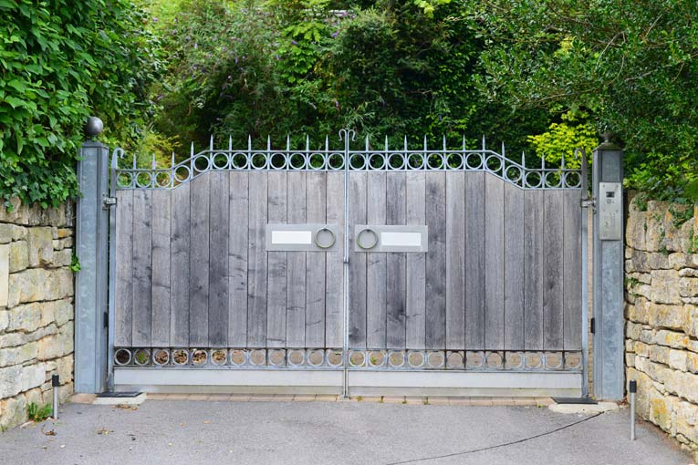 Wood-and-steel swinging driveway gates