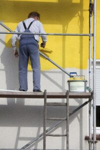Scaffolding makes the job of painting a two-story home much easier than painting with ladders.