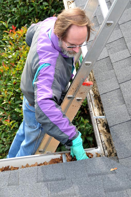 Work from a sturdy ladder and wear gloves to protect your hands from sharp metal and sheet metal screws.