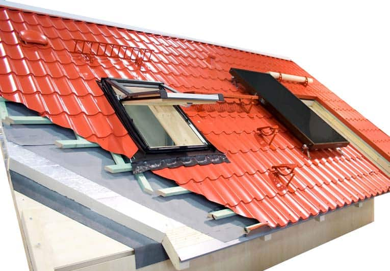 This diagram shows how a metal roof is built, including battens used for attachment and installation of a skylight and solar panel.