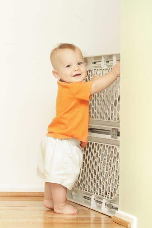 baby at child safe baby gate
