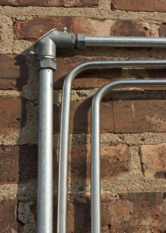 Thinwall metal conduit can be curved to take corners or, for large sizes, can be fitted with elbows.