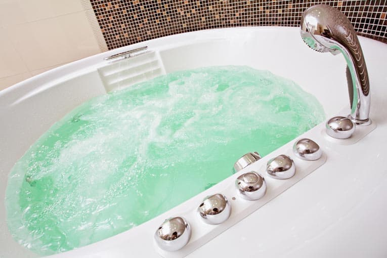 Whirlpool bathtub churns up a luxurious, soothing bath. Many shapes and styles are made.