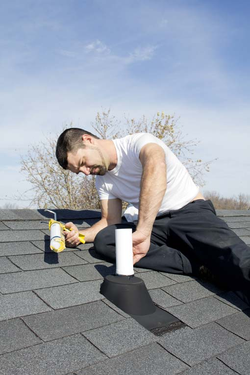 Leaks often occur at the flashing in valleys or where pipes penetrate the surface. Seal these with asphalt roofing cement.