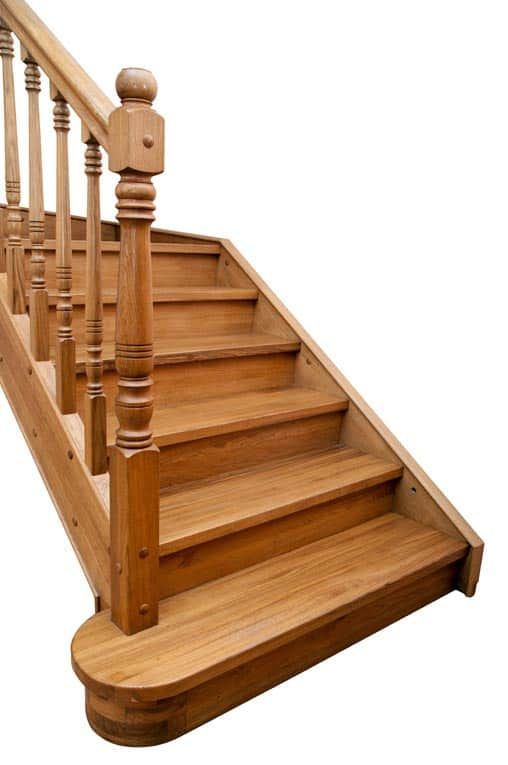 Manufactured hardwood stair system has standard-sized components that are designed for easy assembly and minimal customization.