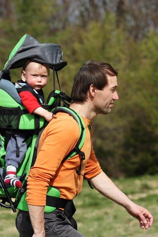 Riding in a fully-outfitted baby backpack lets baby hike with dad.
