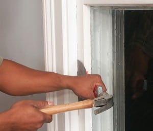 Work a stiff, wide-bladed putty knife between the sash and the frame, and then tap it with a hammer.