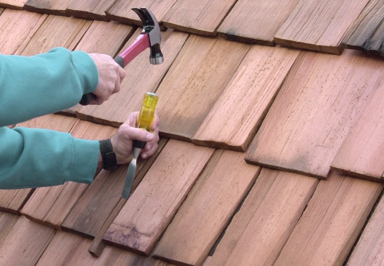 To remove a damaged wood shingle, split it with a wood chisel and pull out the pieces.