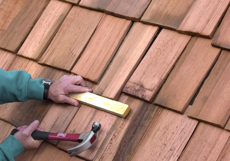 Drive the replacement shingle up into place, leaving it's butt about 3/4 inch lower than the adjacent shingles.
