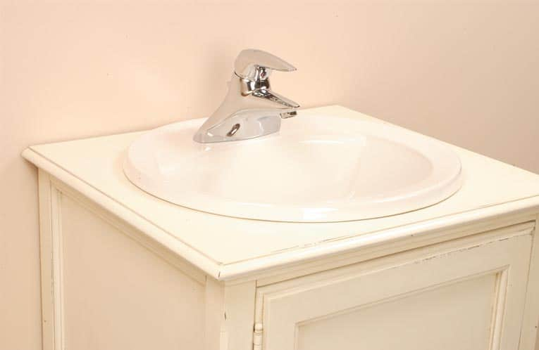 Install a bathroom countertop sink hometips for Replace bathroom countertop