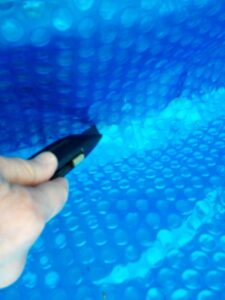 cut pool cover to fit pool