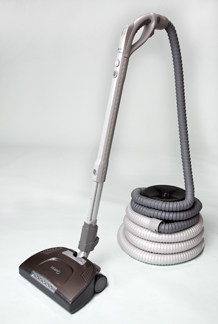 Beam EasyReach central vacuum powerhead connected to a retractable hose.