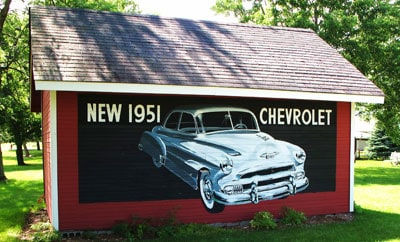 garage with old 1951 painting on the side