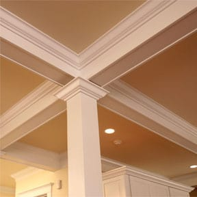Square Wooden Column And Distinctive Moldings Add Style To This Elegant Room