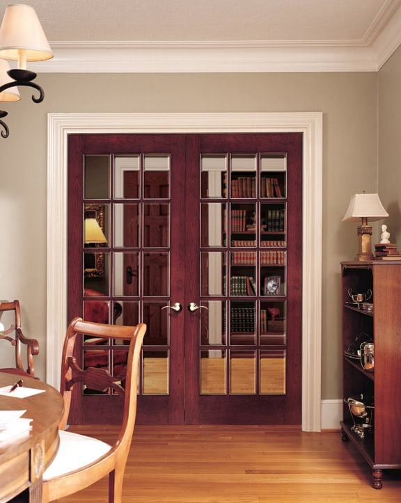 Wooden french door with clear glass panels.